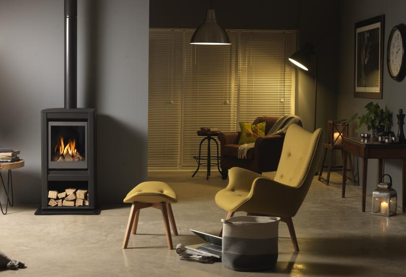 Valor Inspire Large Stove lifestyle front on with logs.jpg