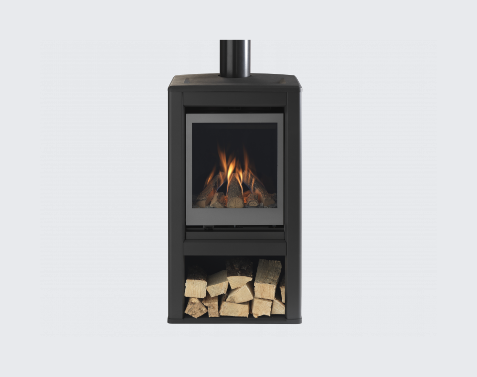 Valor Inspire Large Stove lifestyle front on with logs.png